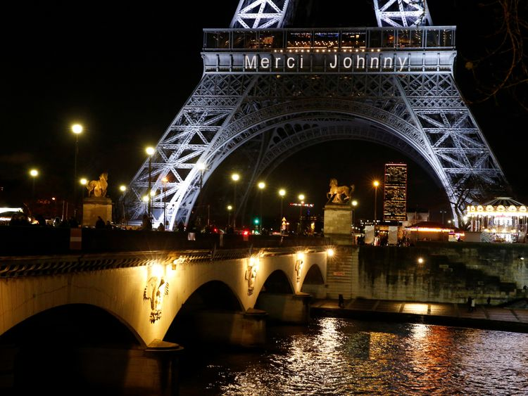 The Eiffel Tower was lit up with 'Merci Johnny'