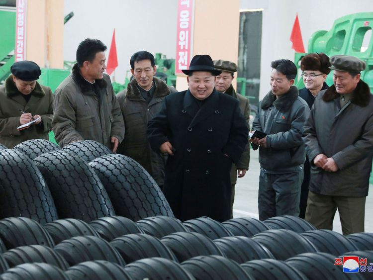 North Korea's leader Kim Jong Un inspects tires at a factory