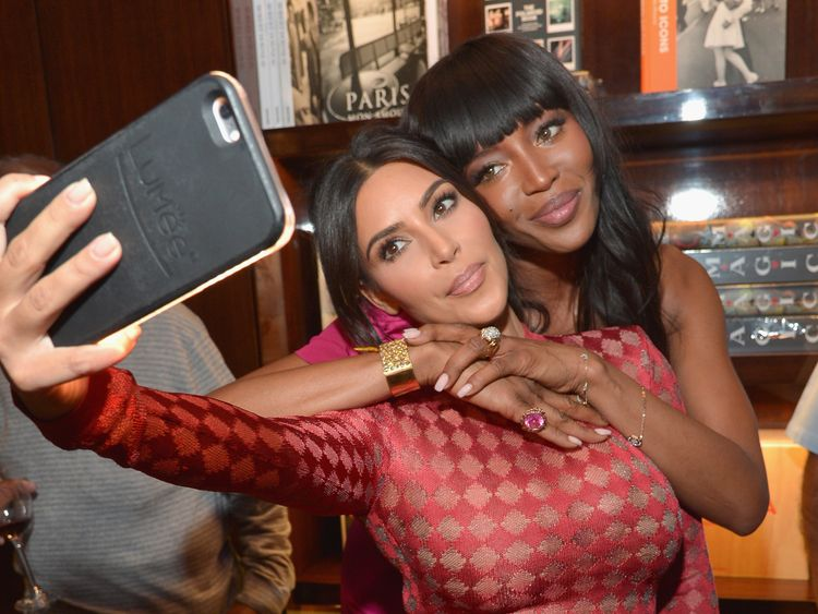 Kim Kardashian and model Naomi Campbell take a selfie during the Los Angeles launch of 'Naomi' at Taschen Beverly Hills on April 28, 2016 in Beverly Hills, California.