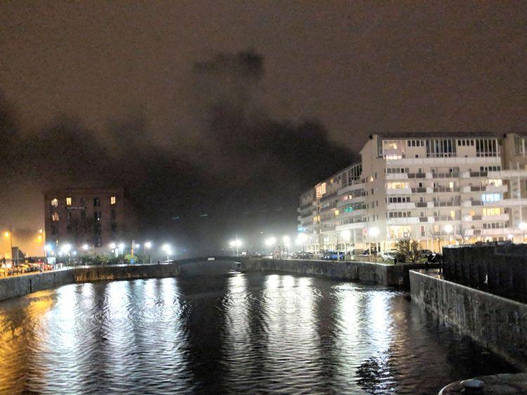 Black smoke billows across Liverpool's waterfront. Pic: Mike Quek/PA Wire