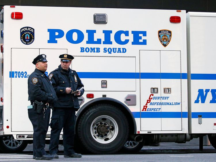 Police officers stand outside the New York Port Authority