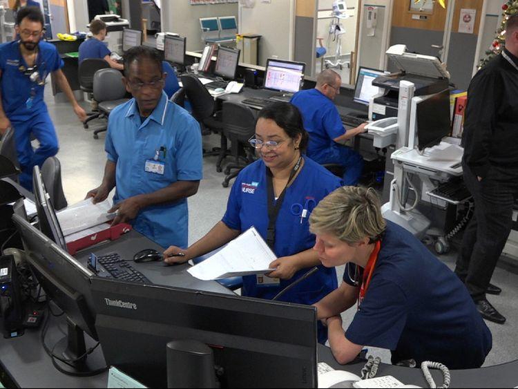 Hospital staff at desks in hospital