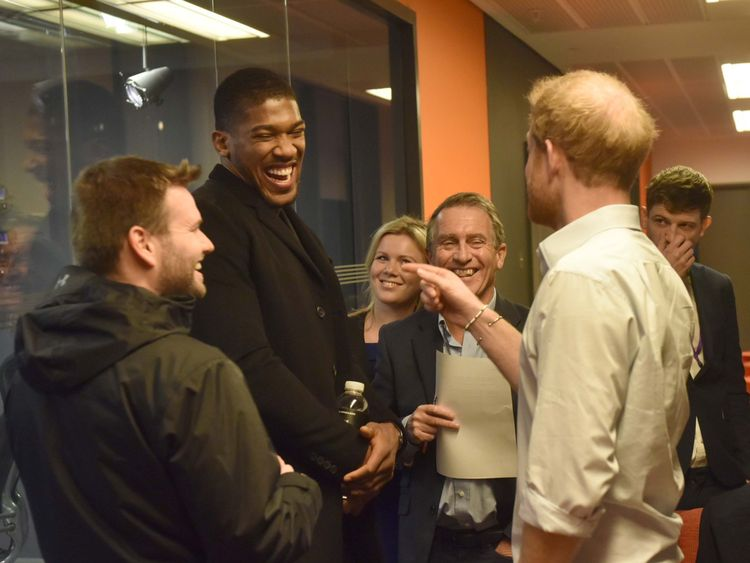 Prince Harry shares a joke with Anthony Joshua during his guest editor role at the Radio 4 Today programme
