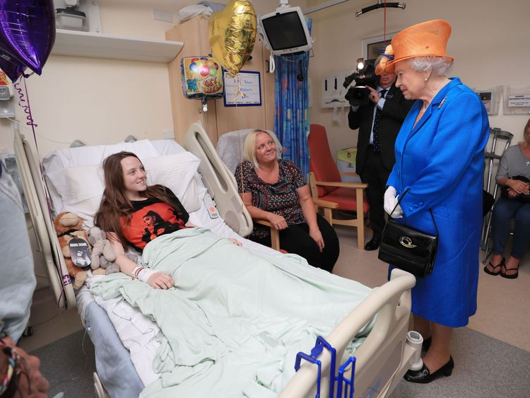 The Queen displayed rare public emotion when she met victims of the Manchester attack in May
