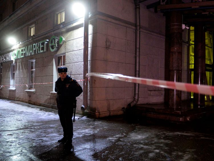 A police officer cordons off the site of a blast in a supermarket in Saint Petersburg on December 27, 2017. / AFP PHOTO / Olga MALTSEVA (Photo credit should read OLGA MALTSEVA/AFP/Getty Images)