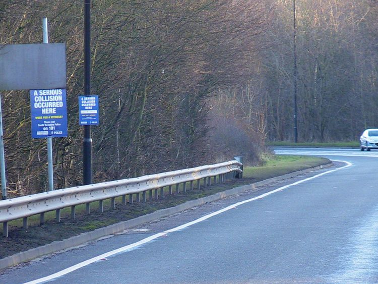Witness appeal signs at the side of the road near the scene of a crash on the A57 in Sheffield