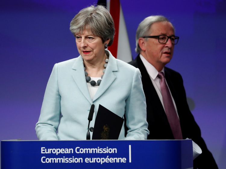 Theresa May and European Commission President Jean-Claude Juncker hold a news conference at the EC headquarters in Brussels