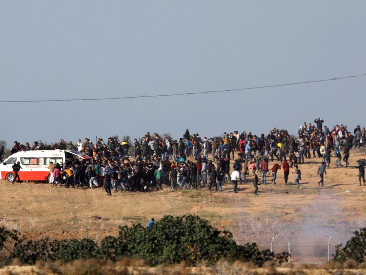 Palestinian protestors evacuate an injured protestor during demonstration at the Gaza side of the Israel-Gaza border