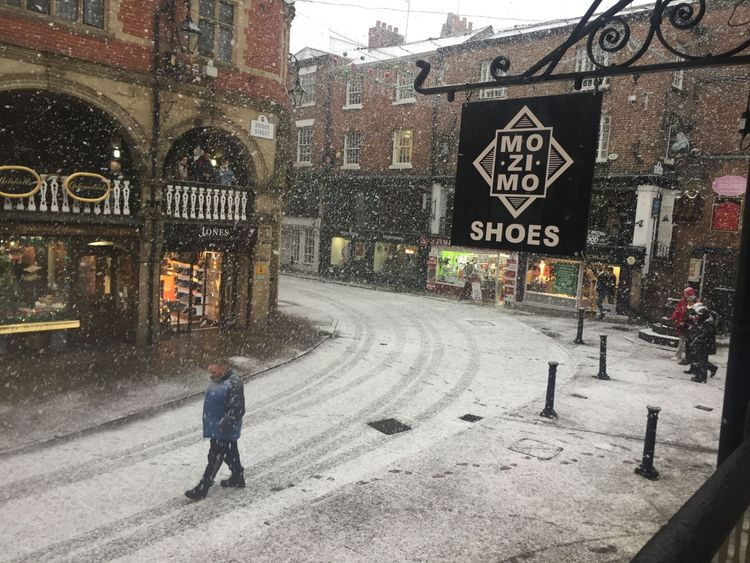Snow falls in Chester, as parts of Britain woke up to a blanket of snow caused by an Arctic airflow in the wake of Storm Caroline