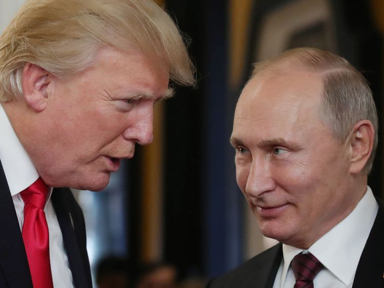 US President Donald Trump chats with Russia's President Vladimir Putin