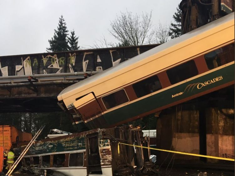 Emergency call from inside derailed Amtrak train