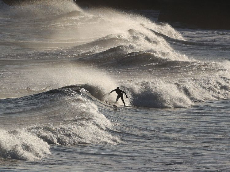 Surfers in the North Sea at Tynemouth following a weekend wintry blast