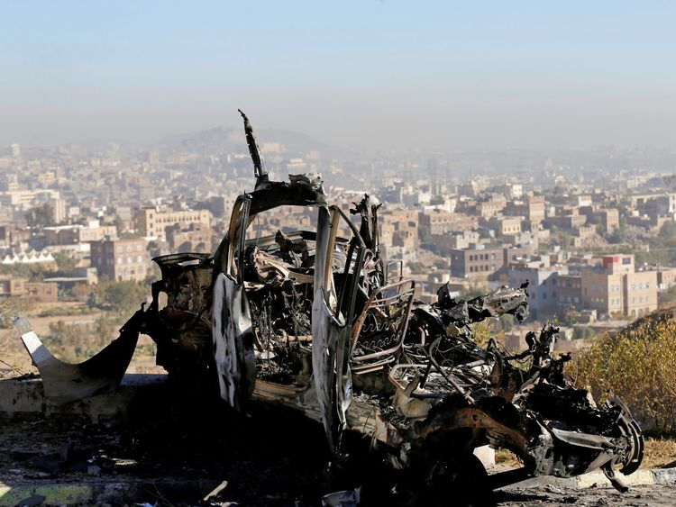 The wreckage of a vehicle at the site of air strikes in Sanaa Yemen