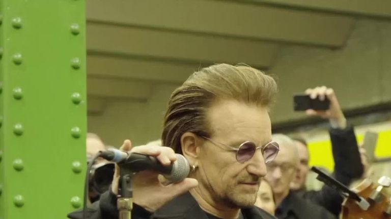 U2 sing for passengers at a train station in Berlin, Germany - Bono pictured