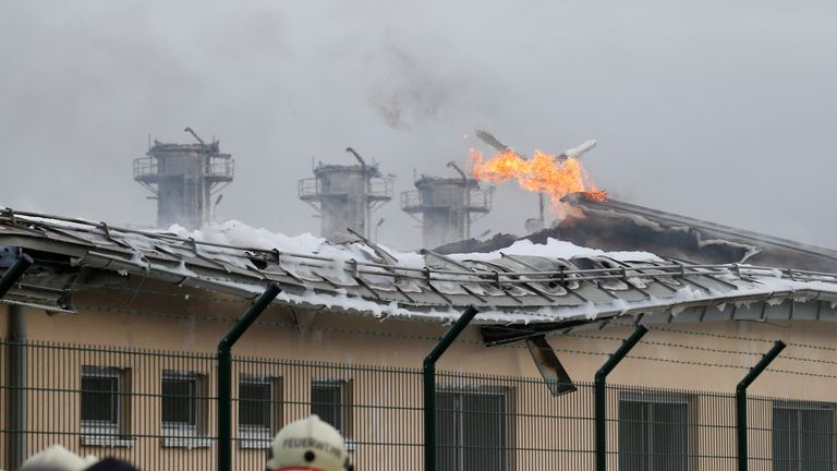 Firefighters are seen at the largest natural gas import and distribution station after a gas explosion in Baumgarten, Austria