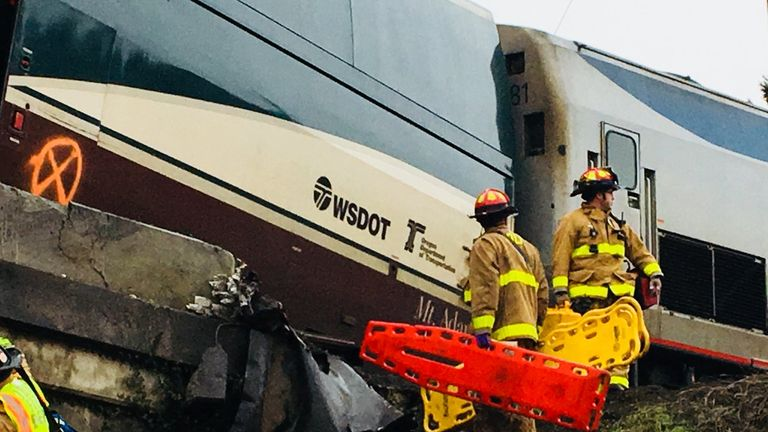 Emergency services at the scene in Washington after the train derailed. Pic: @PierceSheriff