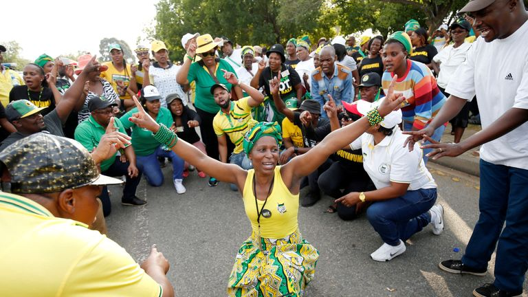 Supporters of Cyril Ramaphosa celebrate outside the ANC's party conference