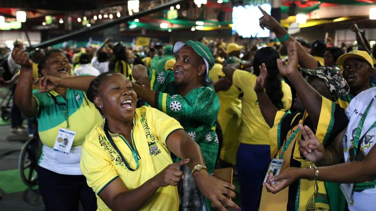 ANC members celebrate after South African Deputy president Cyril Ramaphosa was elected