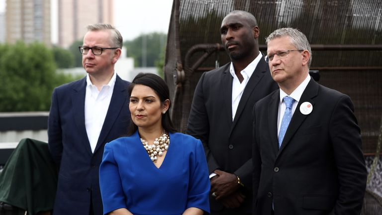 LONDON, ENGLAND - JUNE 04: Justice Secretary Michael Gove (L) Employment Secretary Priti Patel (C-L), former England footballer Sol Campbell (C-R) and Andrew Rosindell MP (R), listen as Boris Johnson MP is interviewed ahead of a Vote Leave rally on June 4, 2016 in London, England. Boris Johnson and the Vote Leave campaign are touring the UK in their Brexit Battle Bus. The campaign is hoping to persuade voters to back leaving the European Union in the Referendum on the 23rd June 2016. (Photo by C