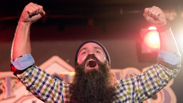 A man celebrates as he takes part in Russia's beard and mustaches championship in central Moscow on April 4, 2015