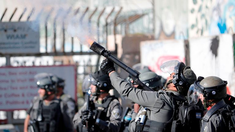 Israeli forces clash with Palestinian protestors near an Israeli checkpoint in the West Bank city of Bethlehem