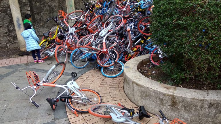 Bicycles from bike-sharing firms near the entrance of Xiashan park in Shenzhen, Guangdong province