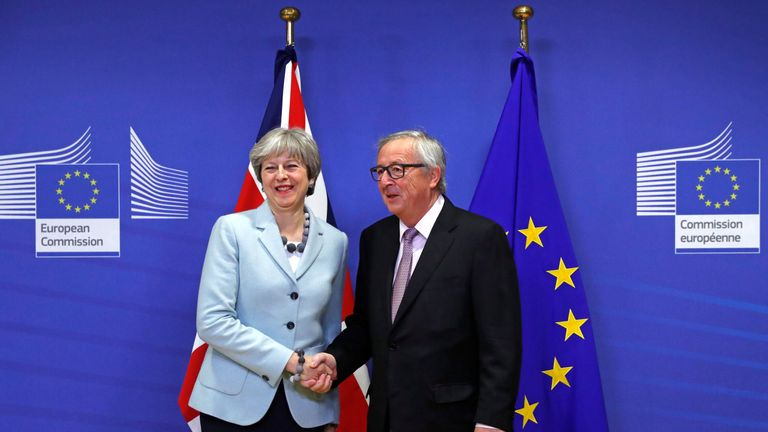 Theresa May is welcomed by European Commission President Jean-Claude Juncker