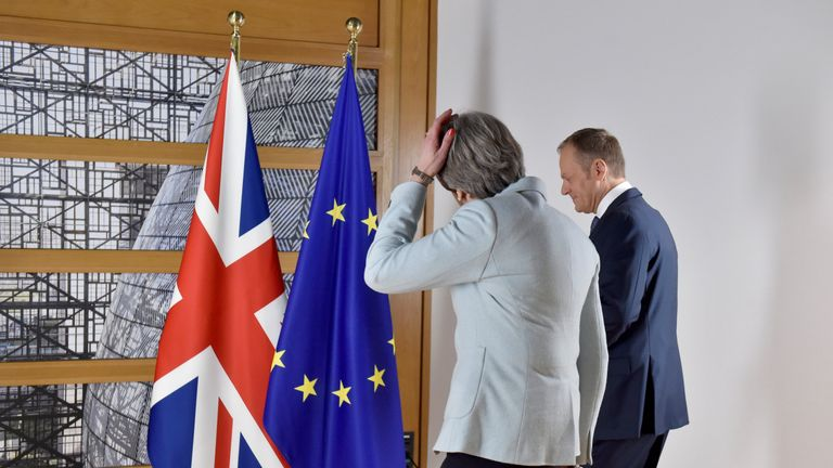 Theresa May arrives with European Council President Donald Tusk