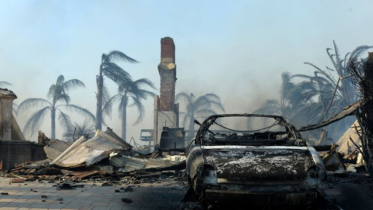 The remains of a home are seen, after it burned to the ground, during a wind-driven wildfire in Ventura