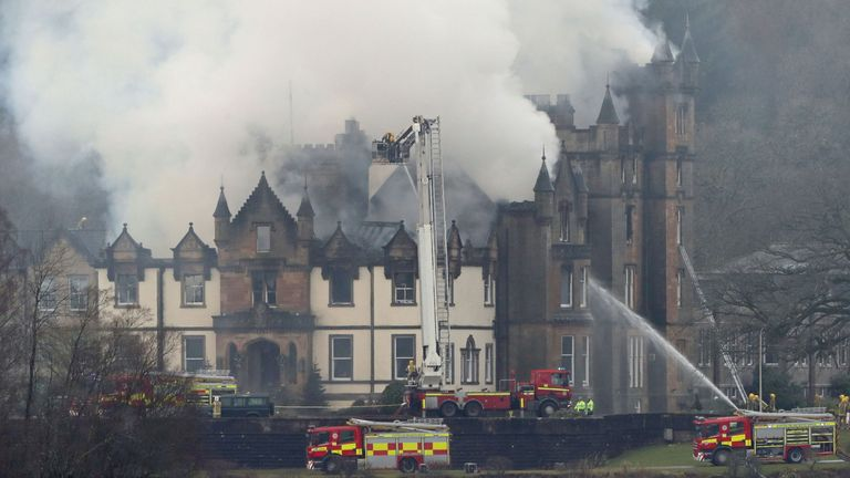 Firefighters use an aerial ladder platform to tackle the flames