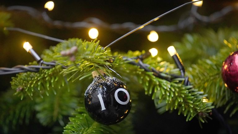 A festive bauble with the number 10 adorns the Christmas tree outside Number 10, Downing Street on December 7, 2017 in London, England. Ms May was joined by children of the Capital Arts Choir during the annual festive switch on.