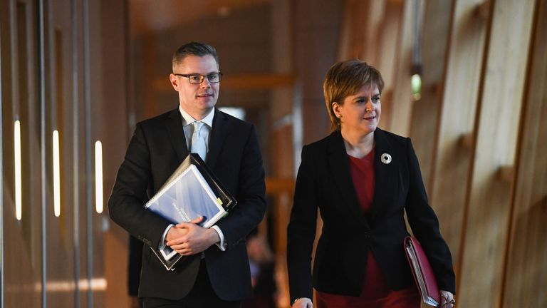 Finance Secretary Derek Mackay and Scotland's First Minister Nicola Sturgeon arrive at the Scottish Parliament ahead of Mr Mackay's draft Budget announcement