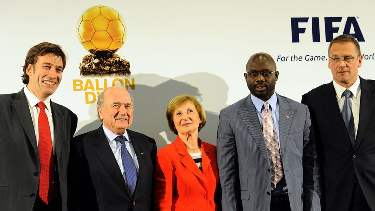 General Director of French sport daily L�Equipe and France Football Francois Moriniere, FIFA President Joseph S. Blatter, President of the Amaury Group Marie-Odile Amaury, African football legend George Weah and FIFA Secretary General Jerome Valcke pose for a family photo after the creation of the FIFA Ballon d'Or (Golden Ball) award during a FIFA and France Football joint press conference on July 5, 2010 in Sandton, near Johannesburg. AFP PHOTO / STEPHANE DE SAKUTIN (Photo credit should read ST