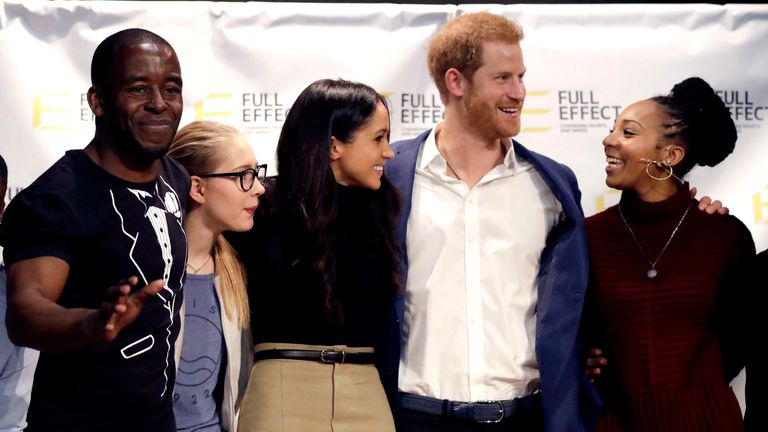 Harry and Meghan with the cast of a hip hop opera put on by the Full Effect programme