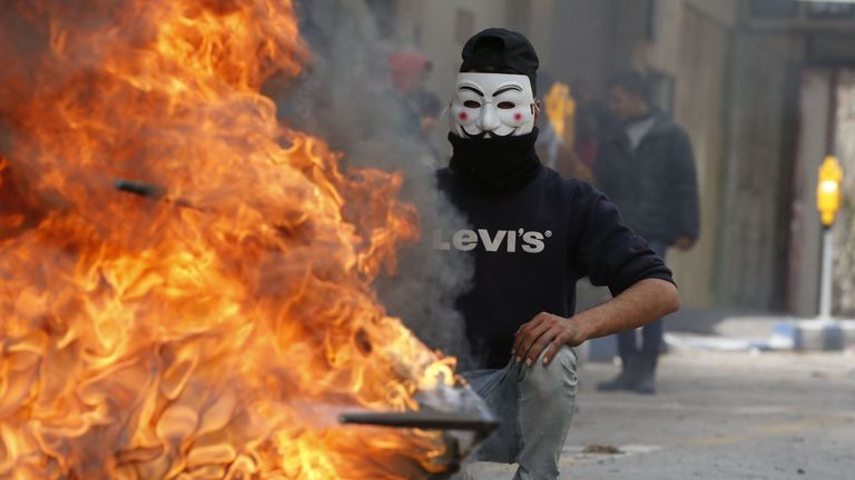 A Palestinian protester during clashes with Israeli troops in Hebron