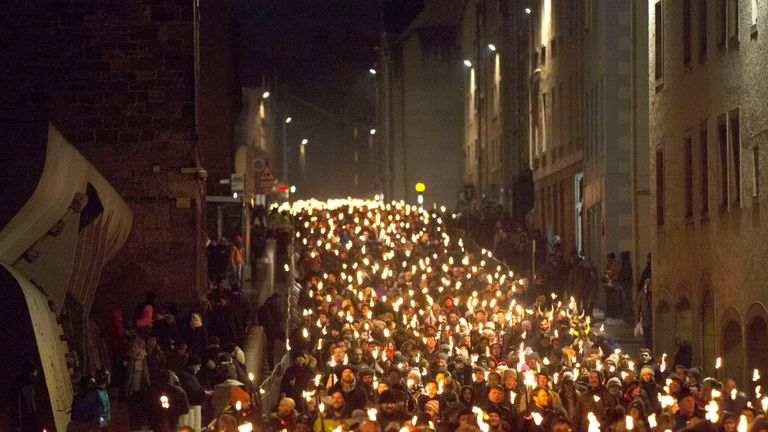A torchlight procession marked the start of Hogmanay celebrations in Edinburgh last night