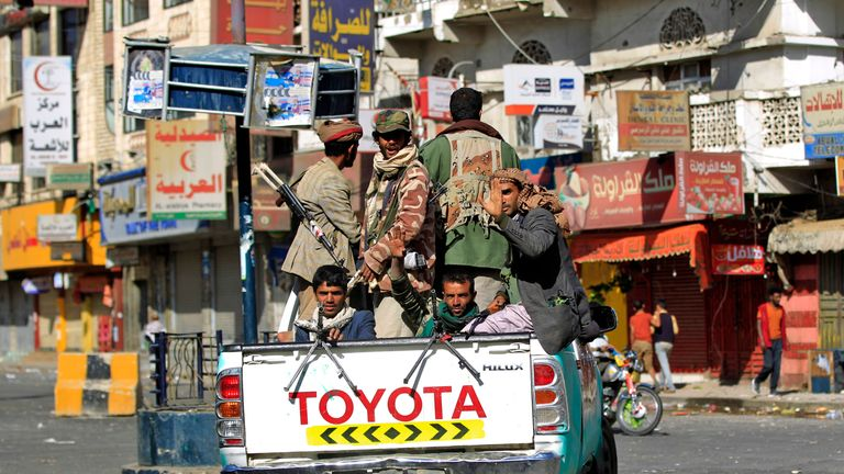 Huthi rebel fighters are seen atop an armoured vehicle in front of the residence of Yemen's former President Ali Abdullah Saleh in Sanaa