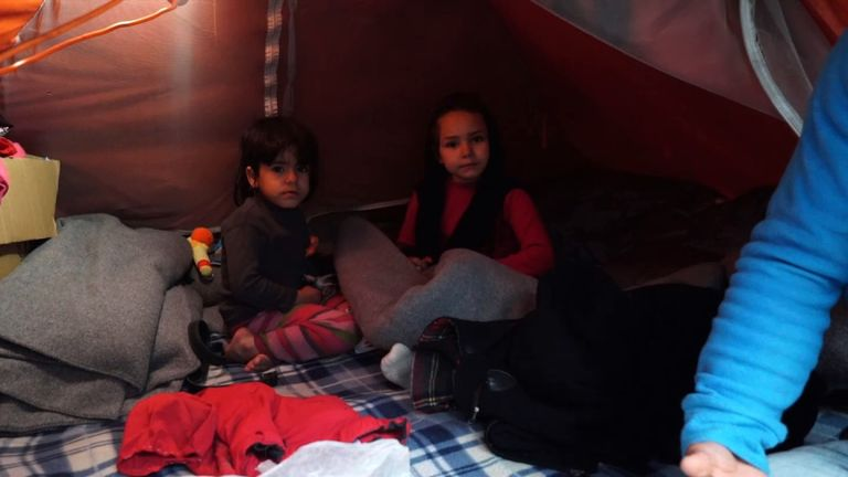Children live in homes made of tarpaulins and canvas awnings