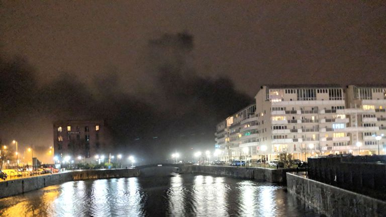 Black smoke billows across Liverpool's waterfront. Pic: Mike Quek/PA Wire