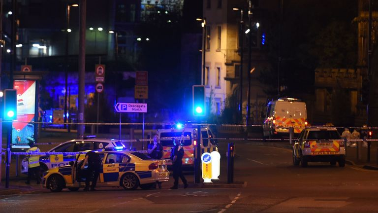 Police deploy at scene of a reported explosion during a concert in Manchester, England, on May 23