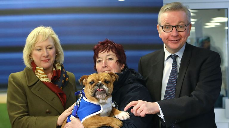 Michael Gove (right) with  Battersea Dogs & Cats Home's Claire Horton (left) and Ali Taylor,  holding Enid the Bulldog