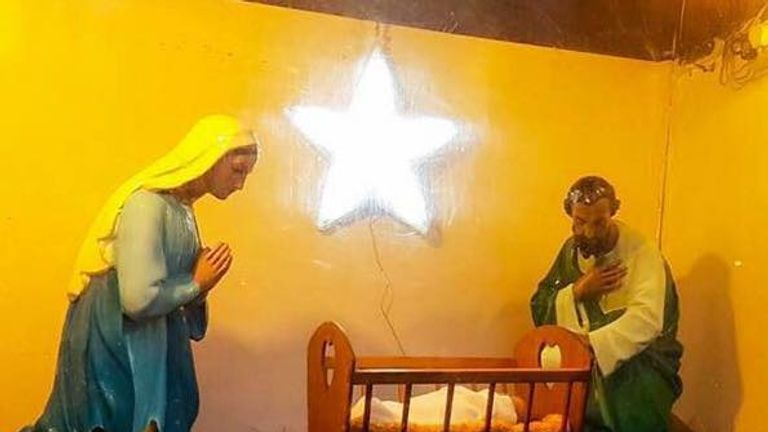 The crib scene which the church puts up each year to encourage donations