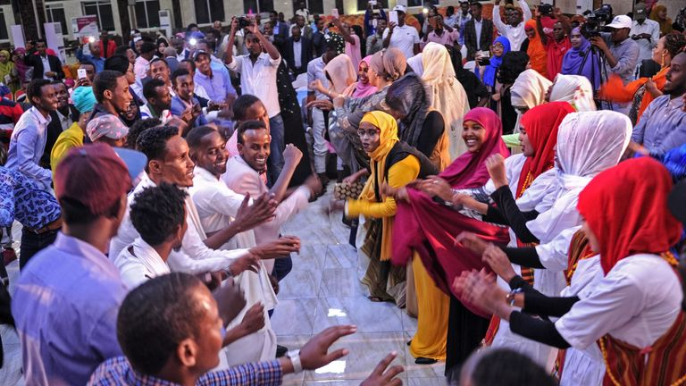 Somali women and men enjoy a traditional dance as they celebrate the coming 2018 on New Year's eve on December 31, 2017, in Mogadishu, Somalia