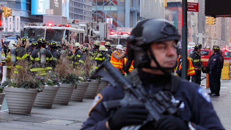Police officers and fire crew outside the New York Port Authority Bus Terminal