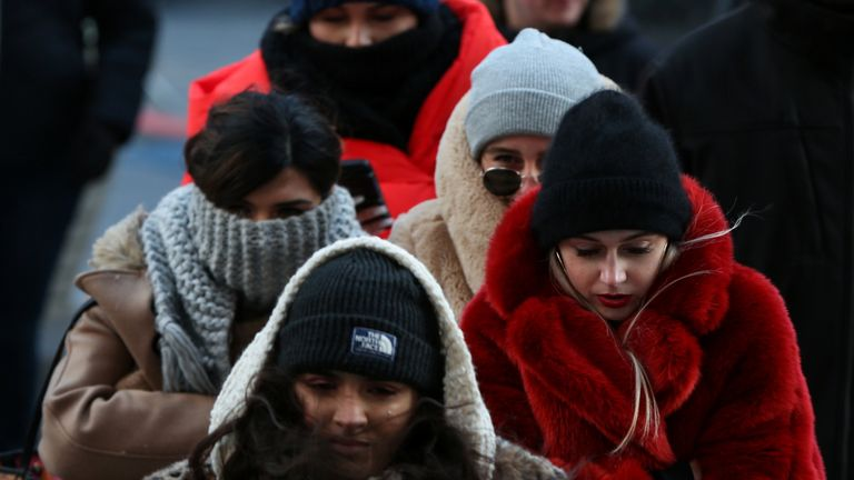 People wrap up against the cold in Times Square