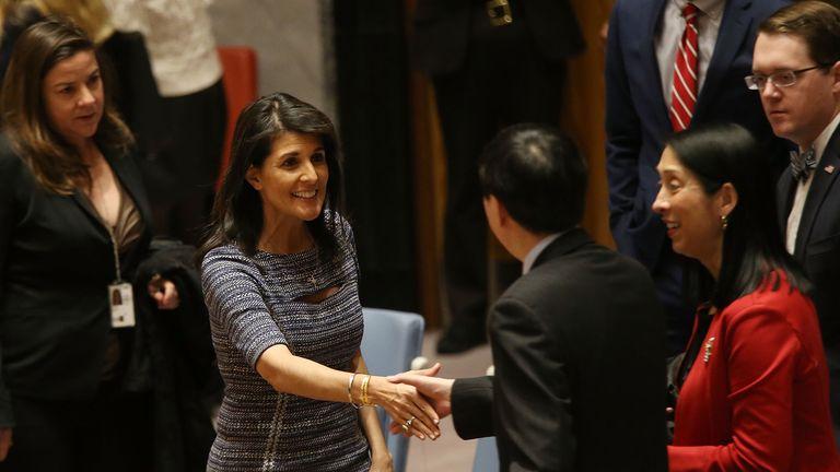 Nikki Haley, the United States Ambassador to the United Nations, speaks with Deputy Permanent Representative Ambassador Wu Haitao