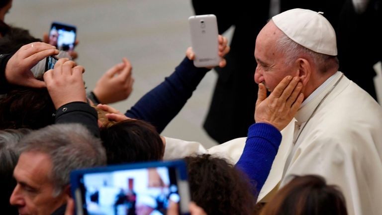 Pope Francis greets people during his audience