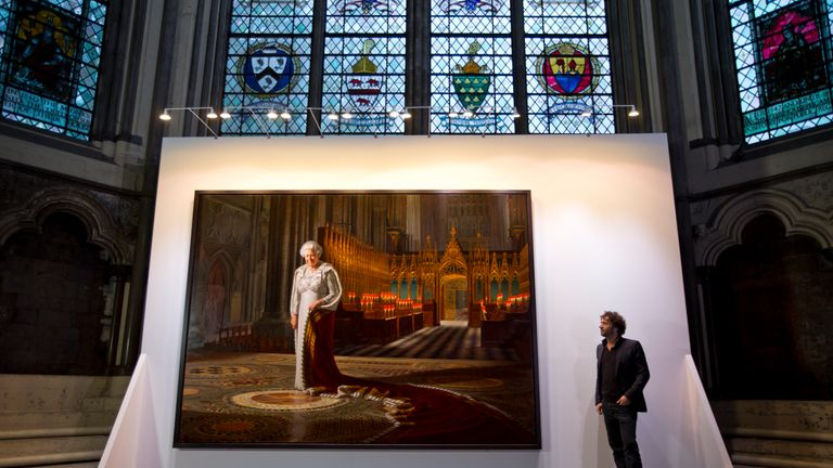 : Artist Ralph Heimans stands beside his painting of Queen Elizabeth II inside the Chapter House at Westminster Abbey on May 17, 2013 in London, England. An official portrait of Her Majesty The Queen has been installed at Westminster Abbey by MOMART Ltd, fine art handlers. The painting, entitled Coronation Theatre: Portrait Of Her Majesty Queen Elizabeth II by artist Ralph Heimans goes on public display for the first time in London in the Chapter House of Westminster Abbey, and will be open to t