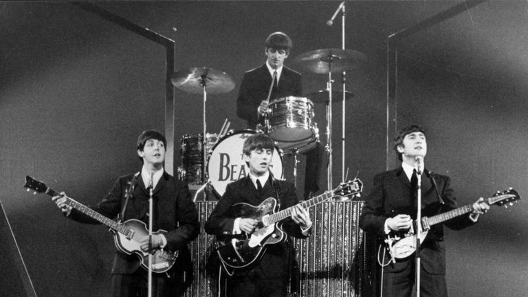 The Beatles on stage at the London Palladium in front of 2, 000 screaming fans