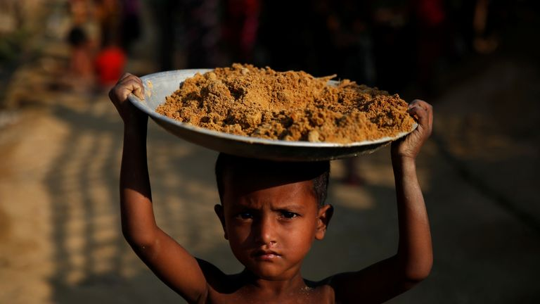 A boy carries a tray on his head in one of the camps in Cox's Bazar